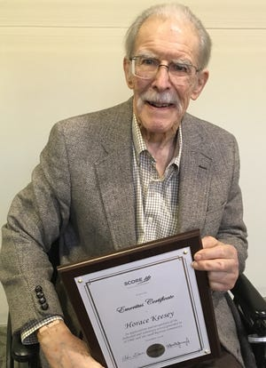 Horace Keesey III holds the Emeritus Certificate presented to him by the Susquehanna SCORE Chapter for his work as a mentor with businesses.