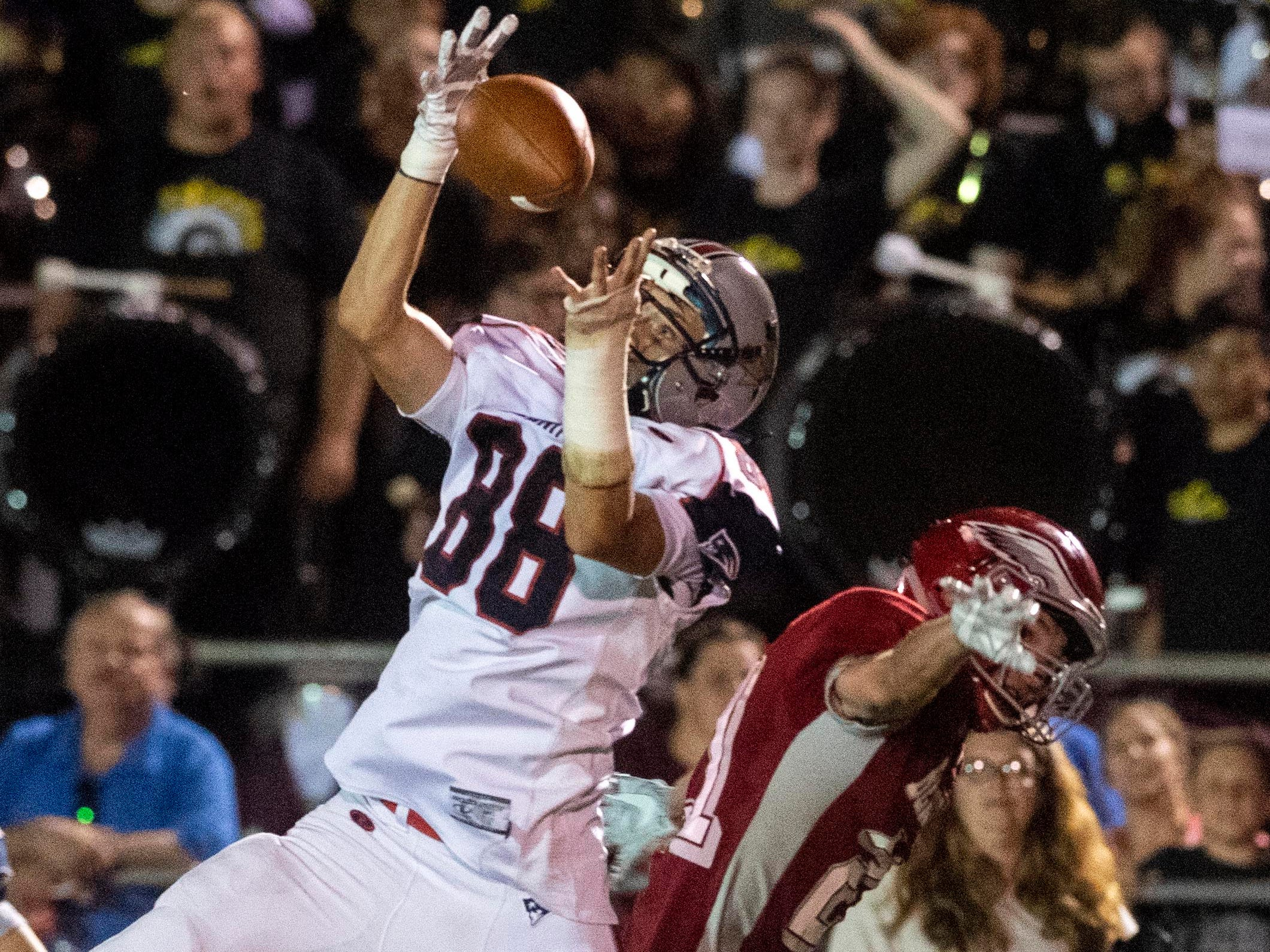 New Oxford's Chase Nell (88) leaps up for a catch over a Bermudian Springs' defender, Friday, Aug. 24, 2018. The Eagles skimmed past the Colonials, 28-22.