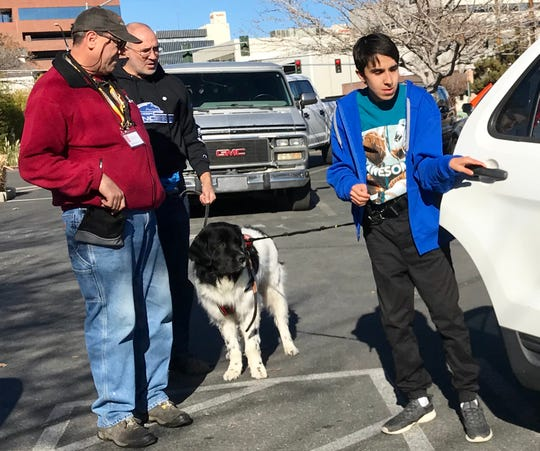 Autism Anchor Dogs Trainer Stephen Meck on right with Kevin Earl and his son Ethan. THe three trained with service dog Mack in downtown Reno on Nov. 25. .