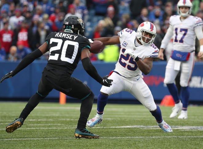 Bills running back LeSean McCoy tries to run past Jaguars Jalen Ramsey.
