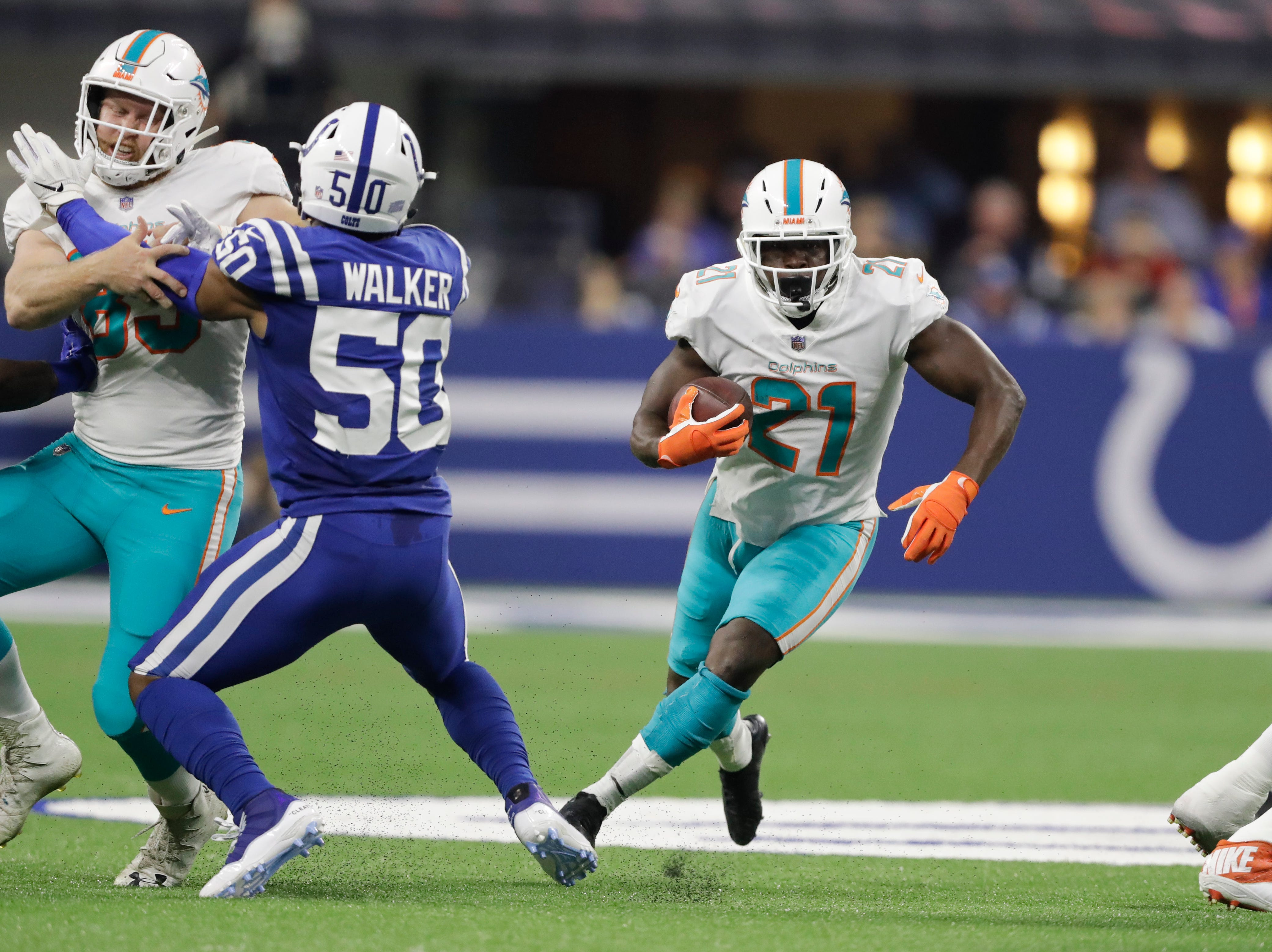 Miami Dolphins running back Frank Gore (21) runs against the Indianapolis Colts. Gore, 35, who faces the Buffalo Bills on Sunday, is fourth on the NFL's career rushing list with 14,621 yards.