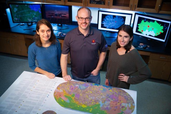 State University College at Geneseo professor Nick Warner, center, and Geneseo students Megan Kopp, left, and Alissa DeMott, right.