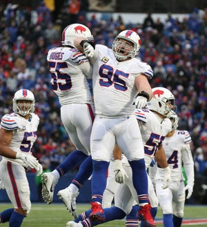 Bills defensive linemen Jerry Hughes (55) and Kyle Williams celebrate a sack of Blake Bortles.