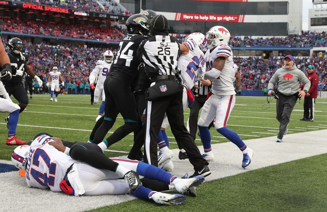 Bills head coach Sean McDermott comes running down the sideline to try and break up a fight as Levi Wallace (47) wrestles with Jaguars receiver Donte Moncrief for control of the ball.  The play was ruled a catch with the ball down at the 1-yard line.  Buffalo's Shaq Lawson and Jacksonville's Leonard Fournette were ejected.
