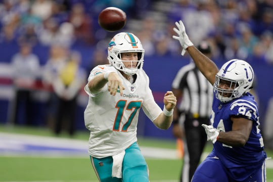 Miami Dolphins quarterback Ryan Tannehill (17) throws over Indianapolis Colts defensive end Tyquan Lewis (94) during the second half of an NFL football game in Indianapolis, Sunday, Nov. 25, 2018. (AP Photo/Darron Cummings)