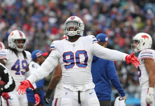 The Bills' Shaq Lawson tries to get the crowd fired up in a 24-21 win over the Jaguars.
