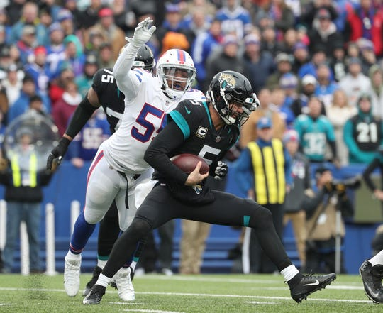 Bills Jerry Hughes pressures Jaguars Blake Bortles.