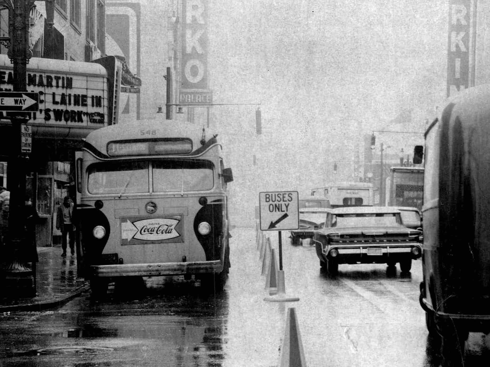 In this 1961 photo, traffic moves north on Clinton Avenue North at Division Street while a Rochester Transit Corp bus heads south in special lane permitting the buses to move opposite to one-way traffic.