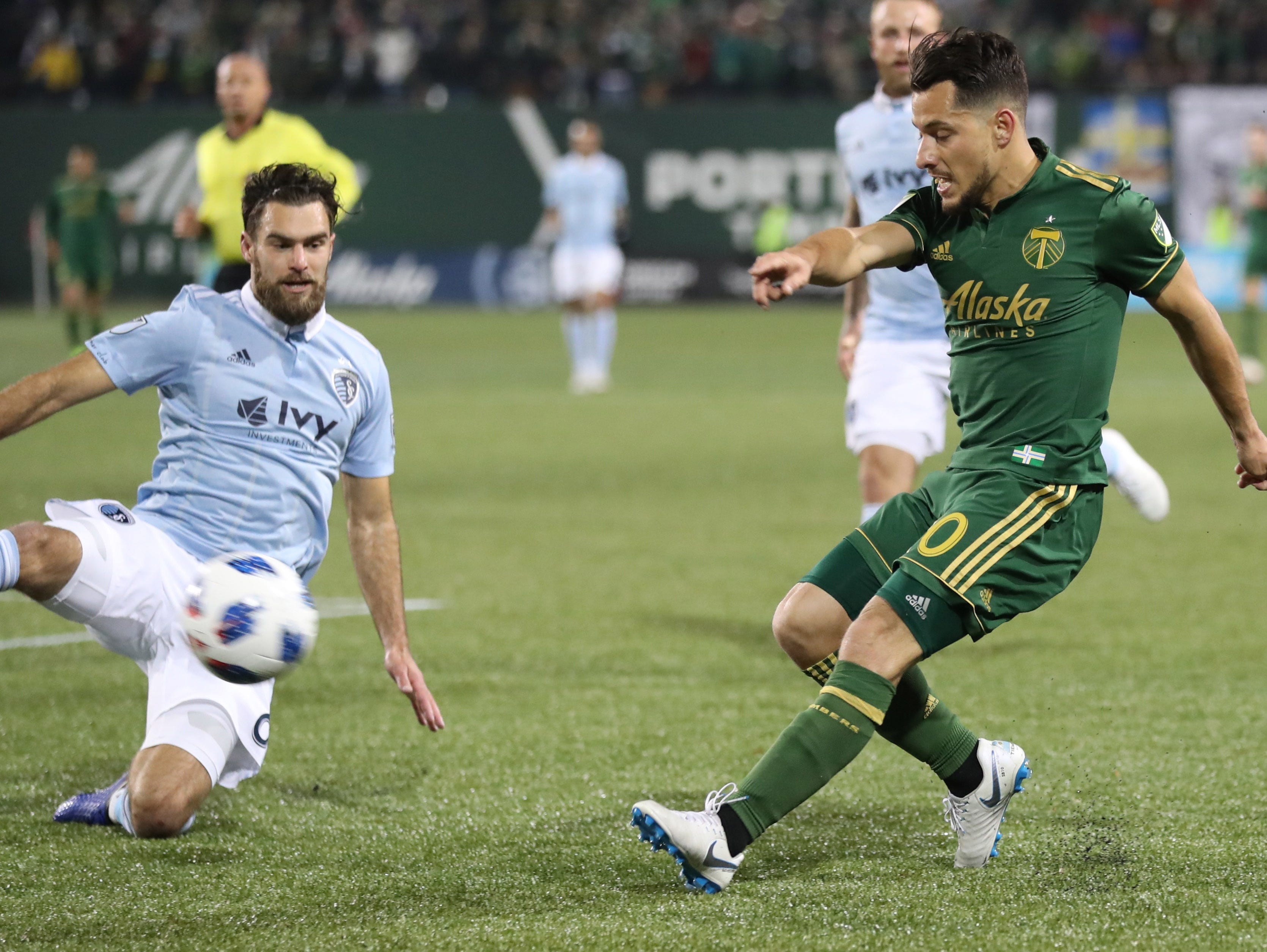 Nov 25, 2018; Portland, OR, USA; Portland Timbers midfielder Sebastian Blanco (10) kicks the ball against Sporting Kansas City midfielder Graham Zusi (8) in the second of the first leg of the MLS Western Conference Championship at Providence Park. Mandatory Credit: Jaime Valdez-USA TODAY Sports