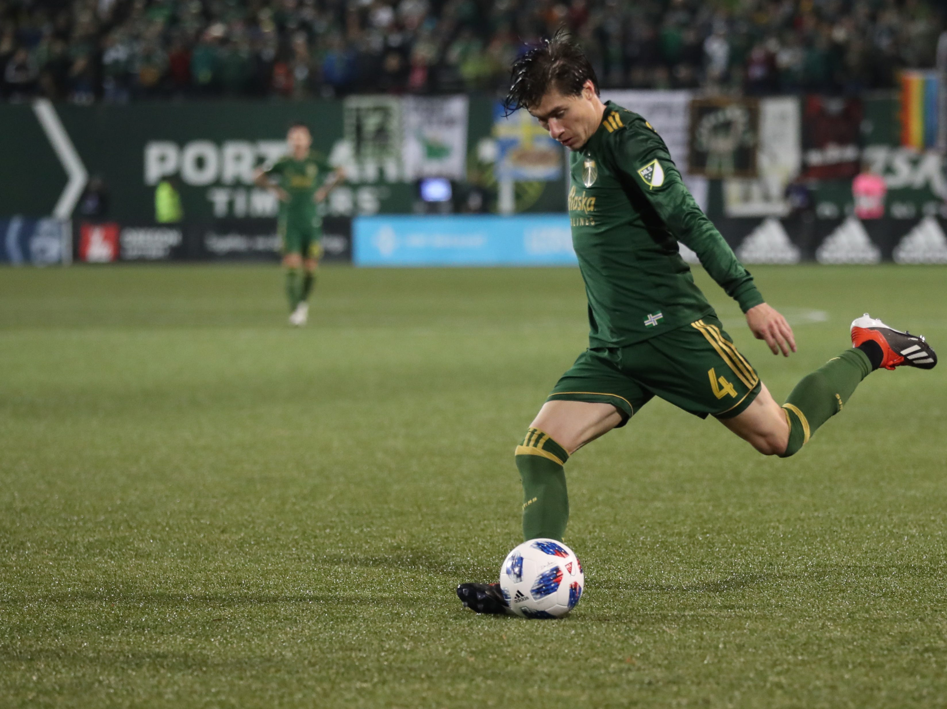 Nov 25, 2018; Portland, OR, USA; Portland Timbers defender Jorge Villafana (4) kicks the ball against the Sporting Kansas City in the second of the first leg of the MLS Western Conference Championship at Providence Park. Mandatory Credit: Jaime Valdez-USA TODAY Sports