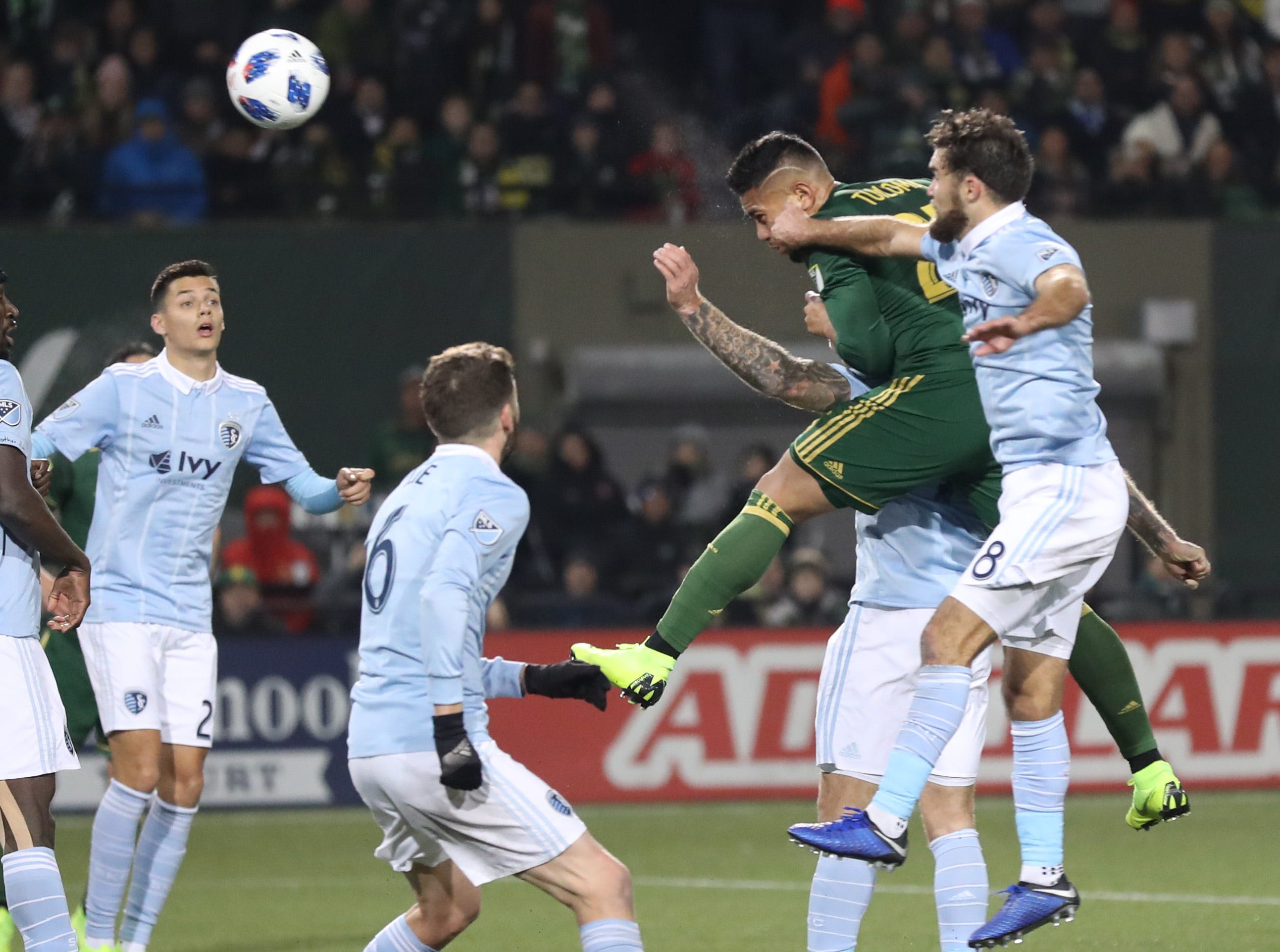 Nov 25, 2018; Portland, OR, USA; Portland Timbers defender Bill Tuiloma (25) heads the ball towards Sporting Kansas City's goal in the second of the first leg of the MLS Western Conference Championship at Providence Park. Mandatory Credit: Jaime Valdez-USA TODAY Sports
