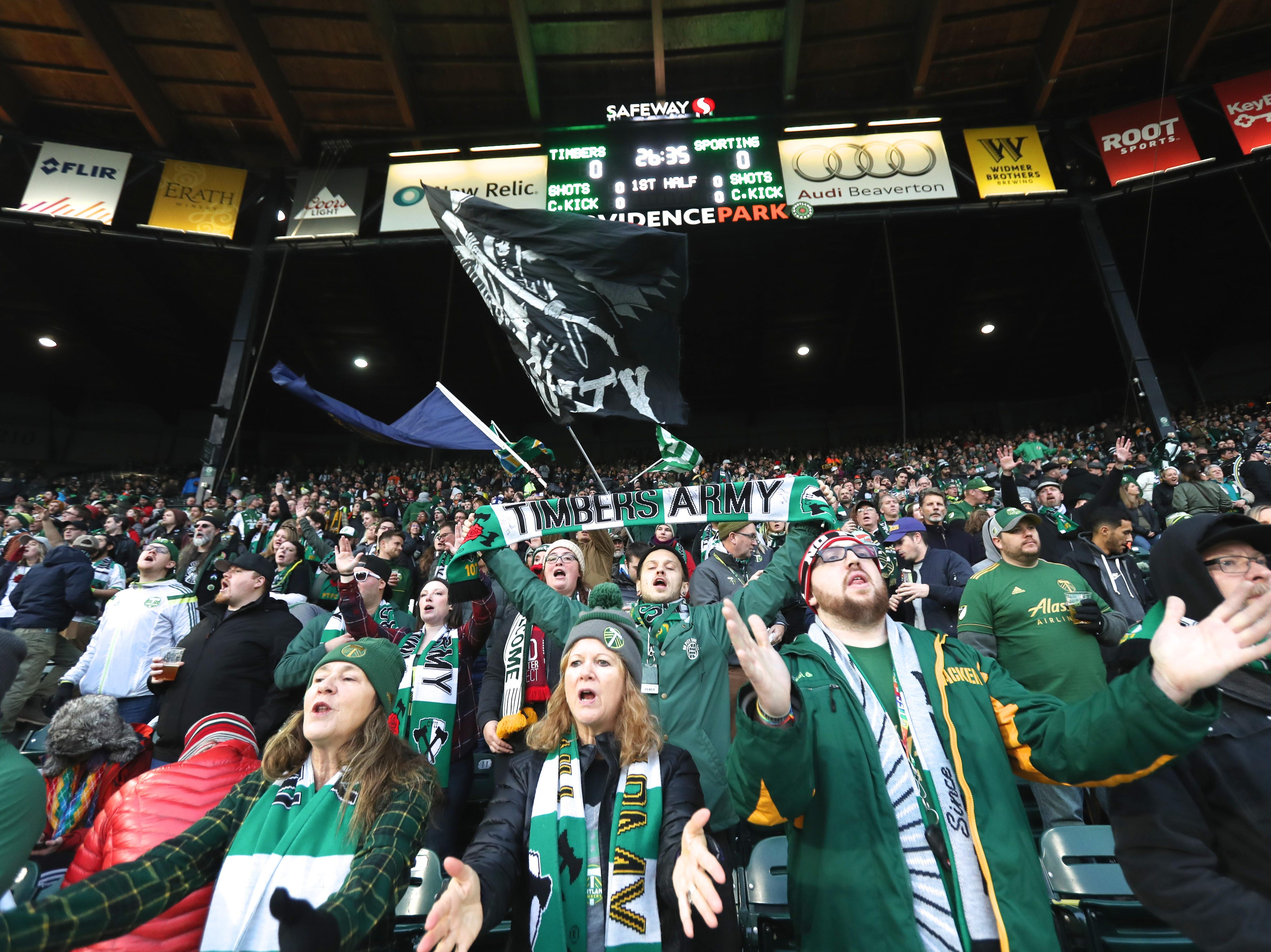 Timbers Army cheer for  Portland Timbers during warm-ups prior to the match against Sporting Kansas City in the first leg of the MLS Western Conference Championship at Providence Park.