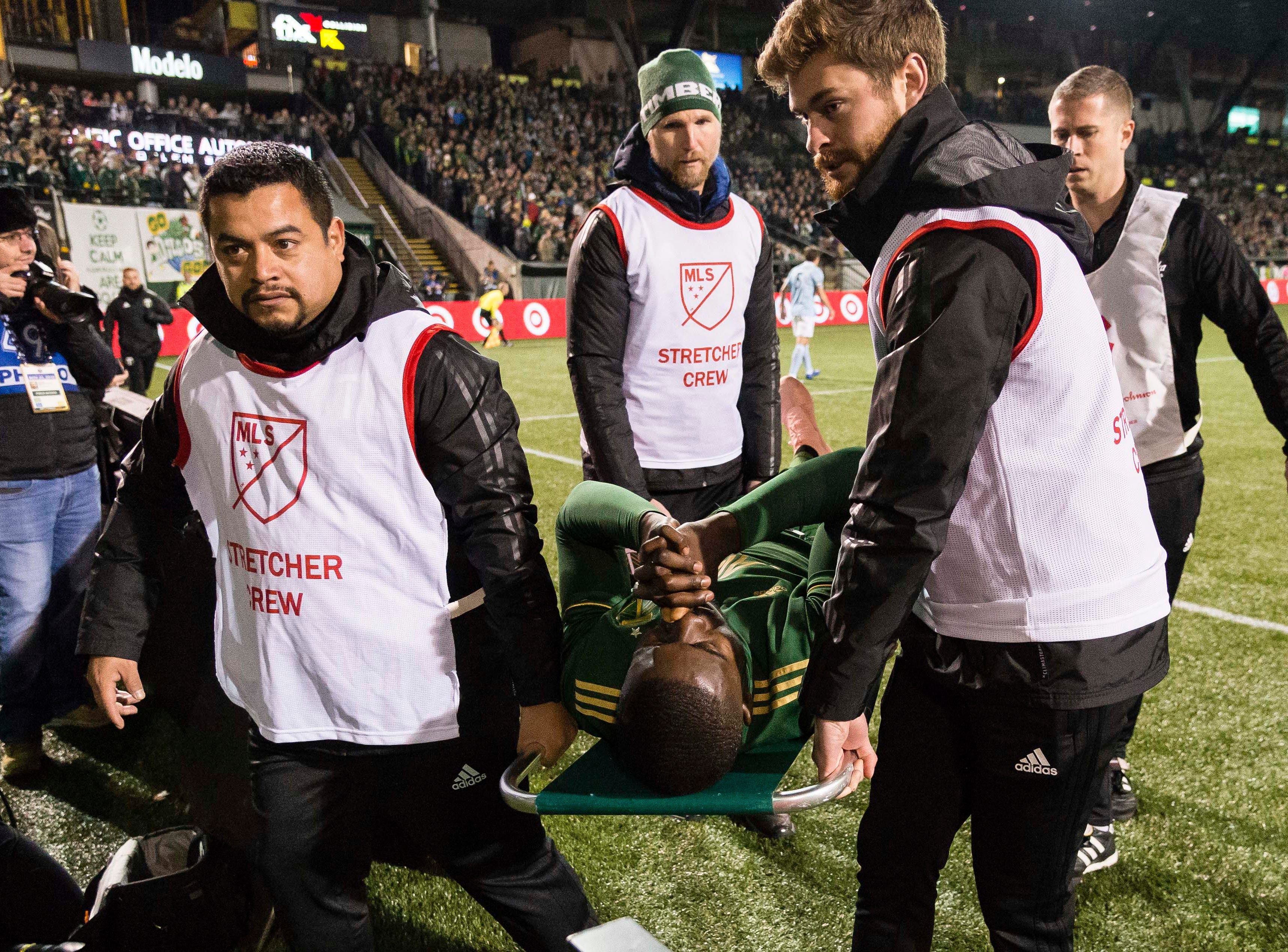Nov 25, 2018; Portland, OR, USA; Portland Timbers defender Larrys Mabiala (33) is taken off the field on a stretcher during the first half against Sporting Kansas City in the first leg of the MLS Western Conference Championship at Providence Park. The game ended tied 0-0. Mandatory Credit: Troy Wayrynen-USA TODAY Sports
