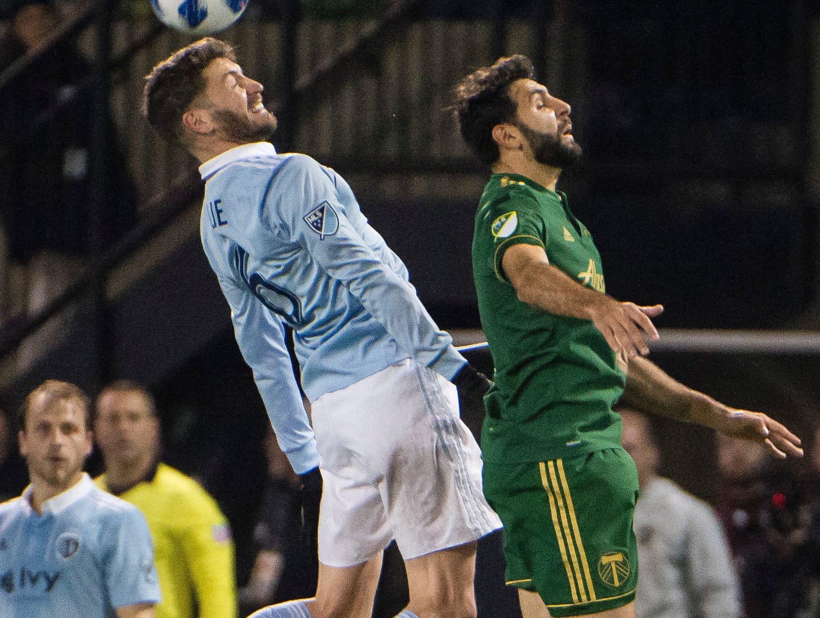 Nov 25, 2018; Portland, OR, USA; Sporting Kansas City midfielder Ilie Sanchez (6) wins a header against Portland Timbers midfielder Diego Valeri (8) during the second half in the first leg of the MLS Western Conference Championship at Providence Park. The game ended tied 0-0.  Mandatory Credit: Troy Wayrynen-USA TODAY Sports