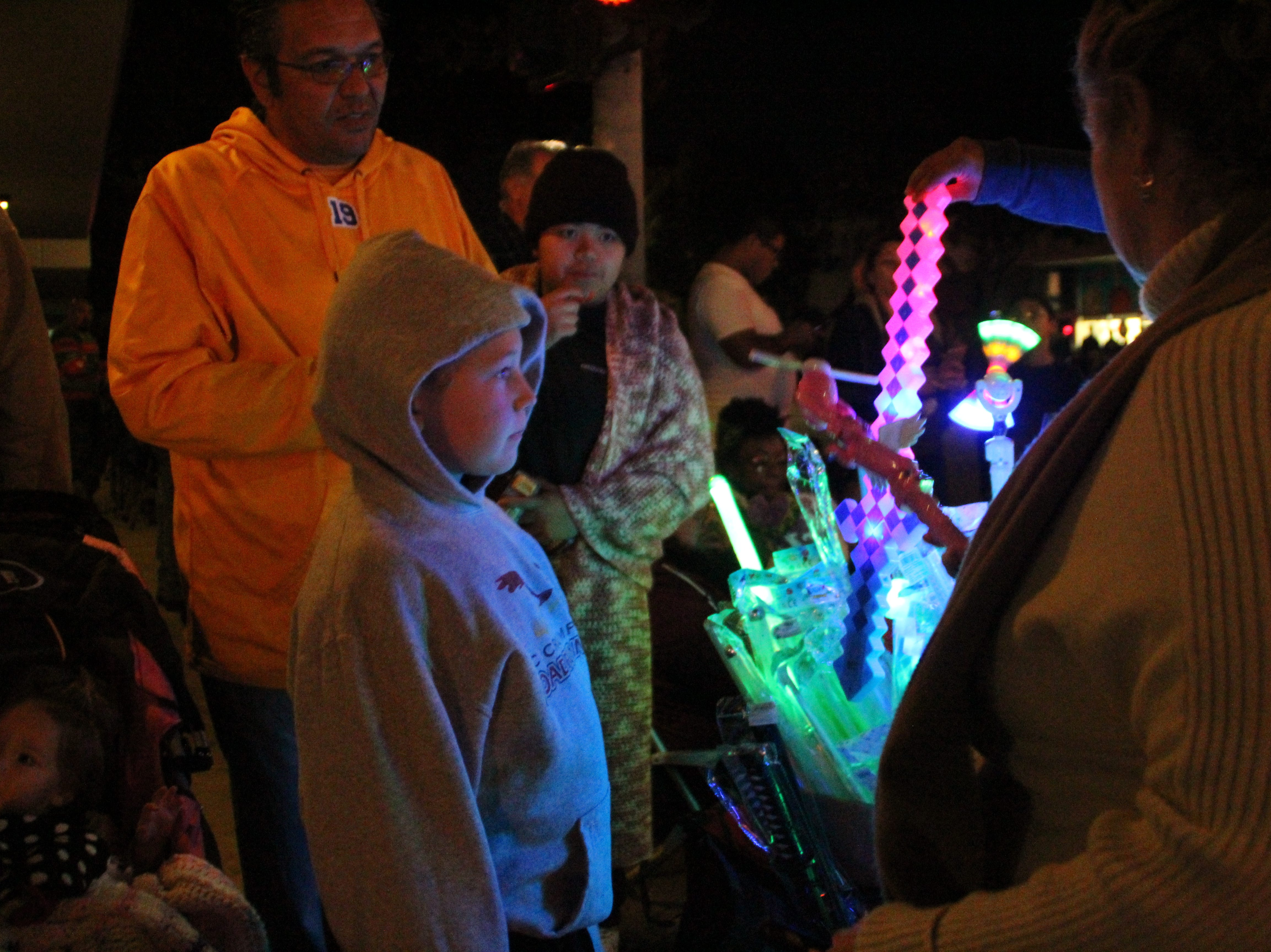 Children look to buy toys sold by Lorena Leon, of Bakersfield, at the Salinas Parade of Lights on Sunday.