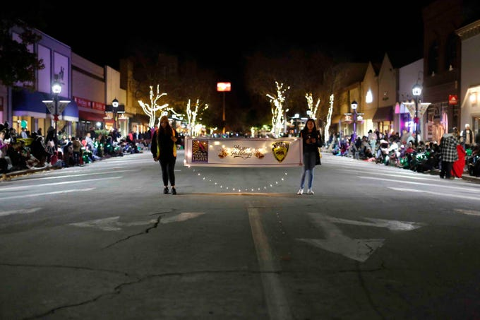 The annual Salinas Holiday Parade of Lights makes its way down Main Street in Old Town Salinas while attendees look on on Sunday, November 25, 2018 in Salinas, Calif.