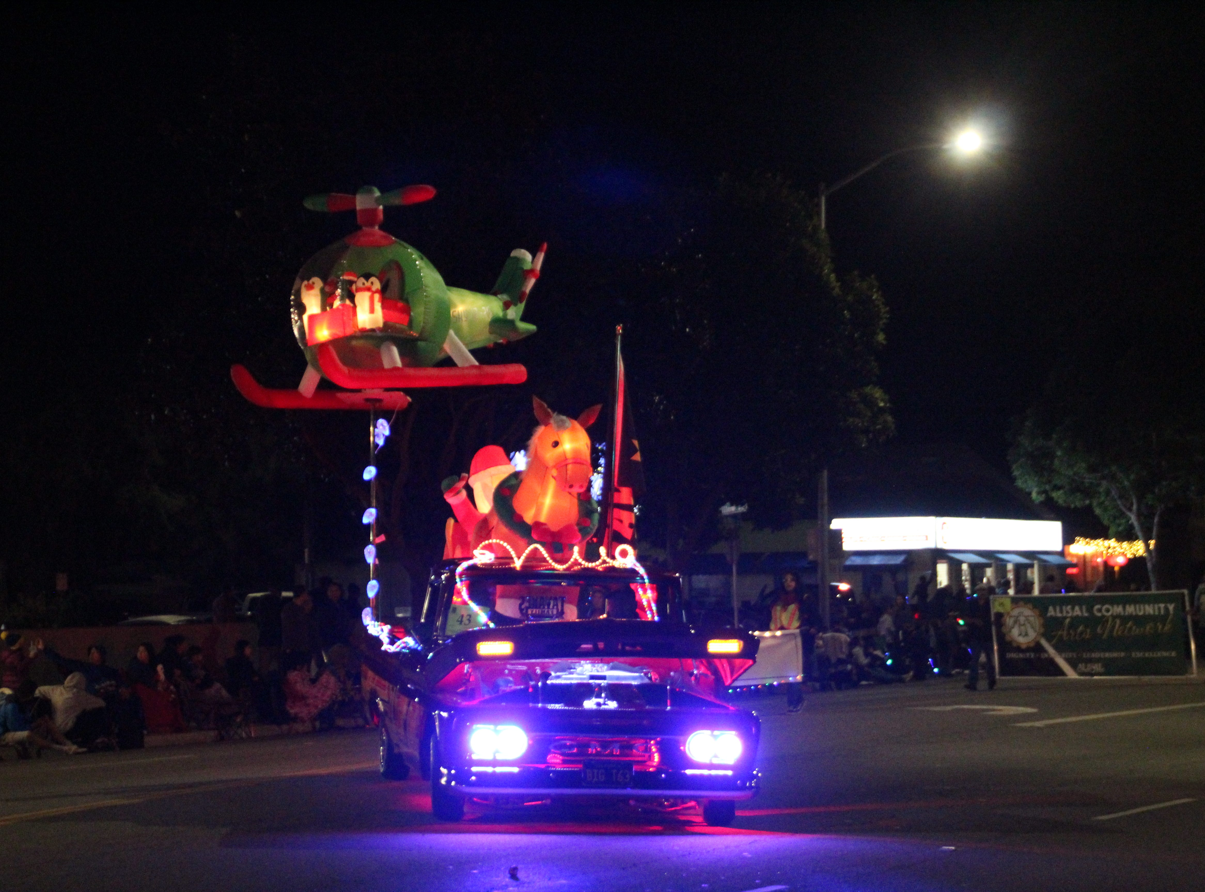 "Terry Milleman's 1963 GMC Truck, nicknamed ""El Diablo"" and part of Salinas' Tavares Family Car Club, featured Santa Claus on top with a Christmas helicopter attached."