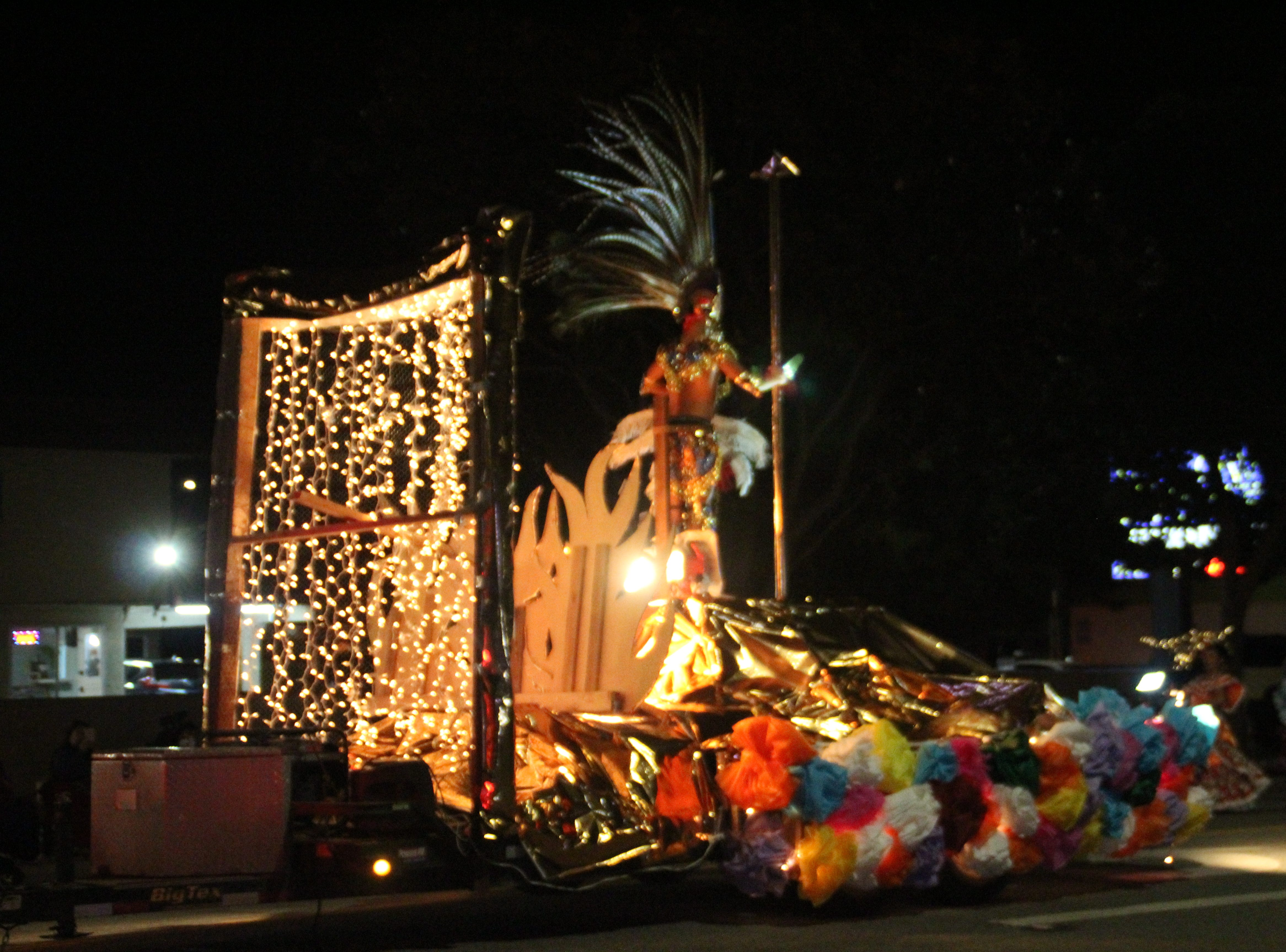 The Tonatiuh Danzantes float features an Aztec leader in front of a group of Mexican dancers.