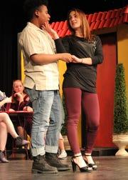 "Freshman Elijah Jackson as Pepper and senior Rayden Hicks as Tanya rehearse a scene from ""Mamma Mia!"""