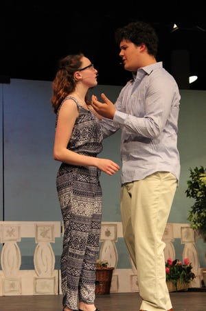 "Seniors Sarah Olson and Bryant Cobb rehearse a scene from ""Mamma Mia!"""