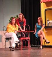"""Junior Leighann Sweet as Rosie, senior Sarah Olson as Donna and senior Rayden Hicks rehearse a scene from """"Mamma Mia!"""""""
