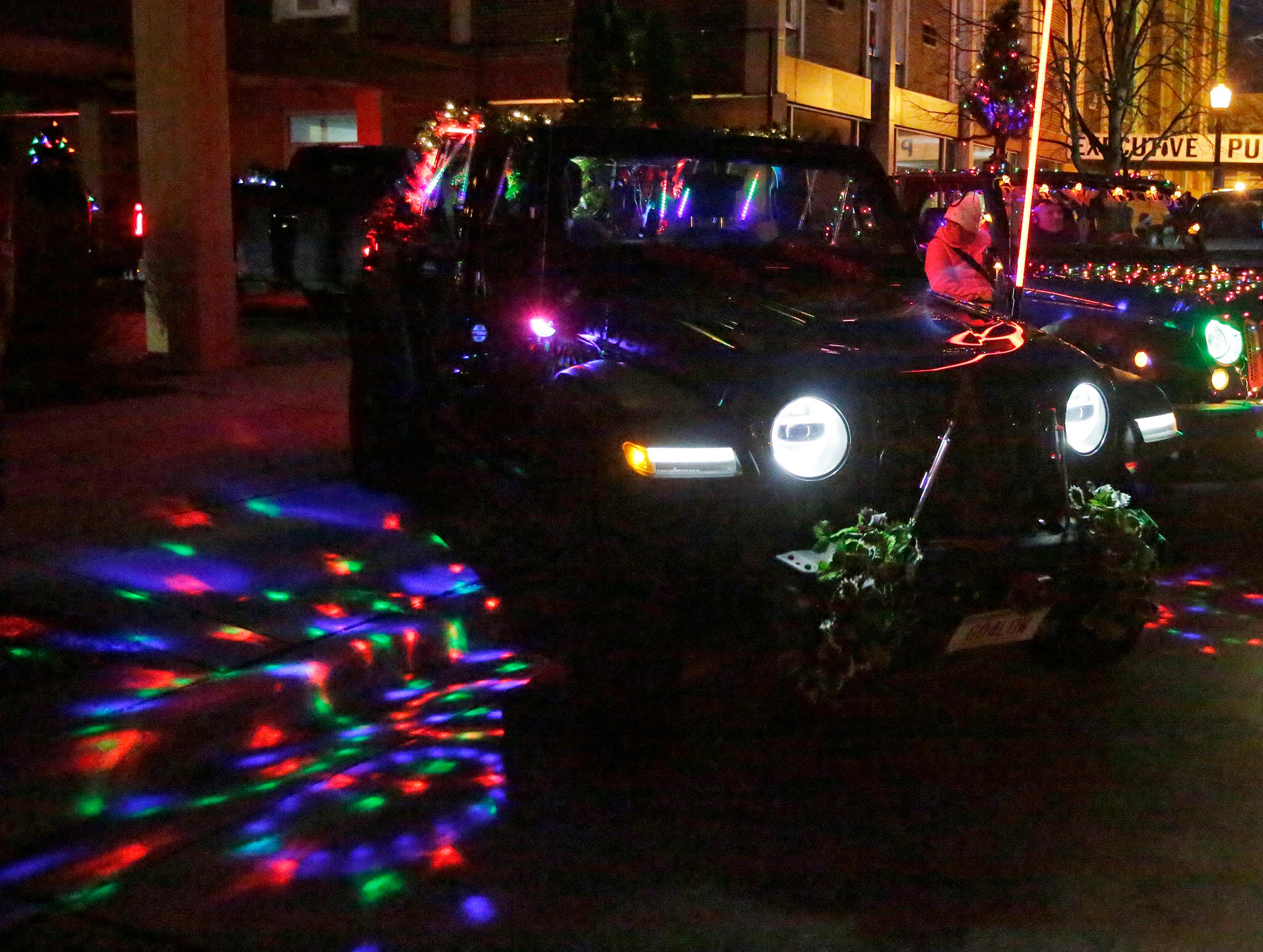 Jeeps light up the scene before the 26th Annual Jaycees Holiday Parade, Sunday, November 25, 2018 in Sheboygan, Wis.