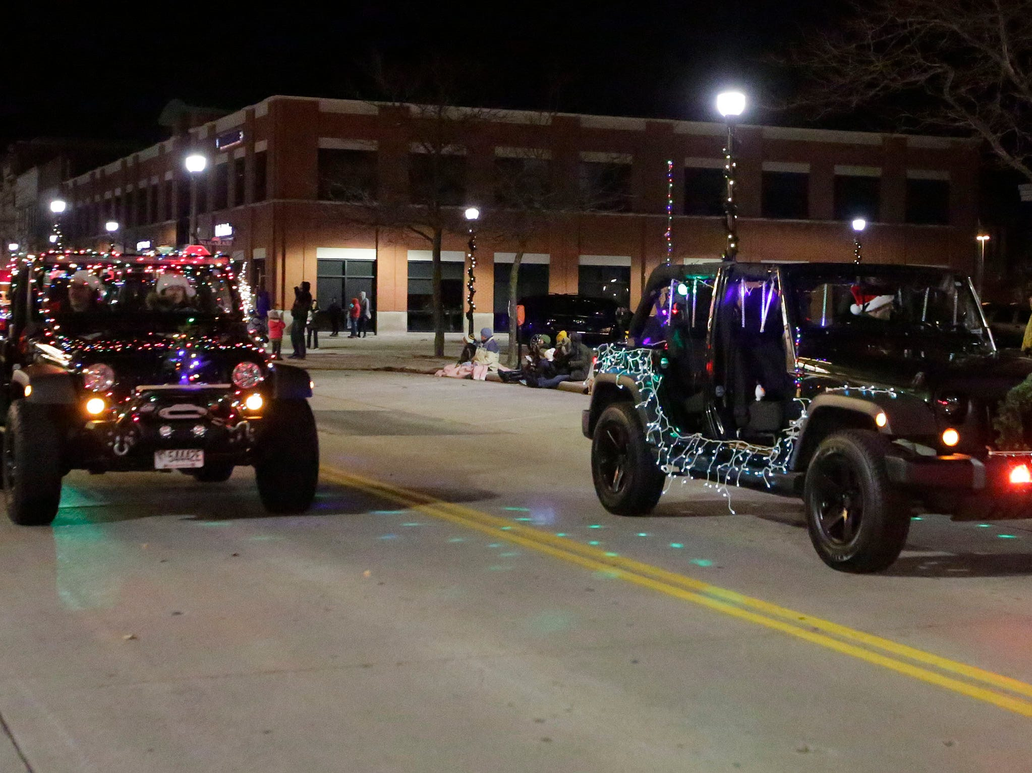 Jeeps light up North 8th Street at the 26th Annual Jaycees Holiday Parade, Sunday, November 25, 2018 in Sheboygan, Wis.
