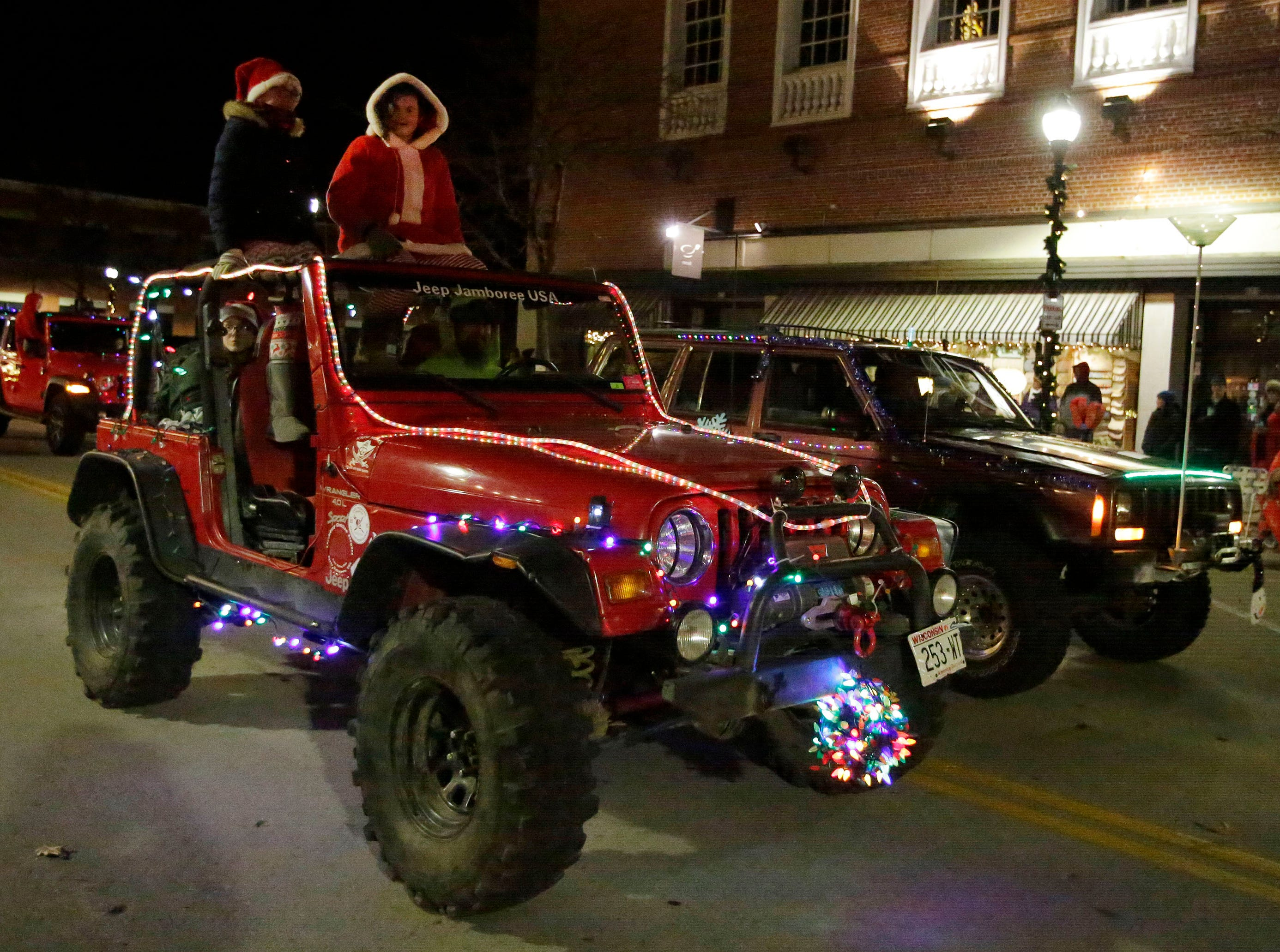 Jeeps are ready for the holidays at the 26th Annual Jaycees Holiday Parade, Sunday, November 25, 2018 in Sheboygan, Wis. Wrangler Jeeps came in first in the non profit division in the parade.