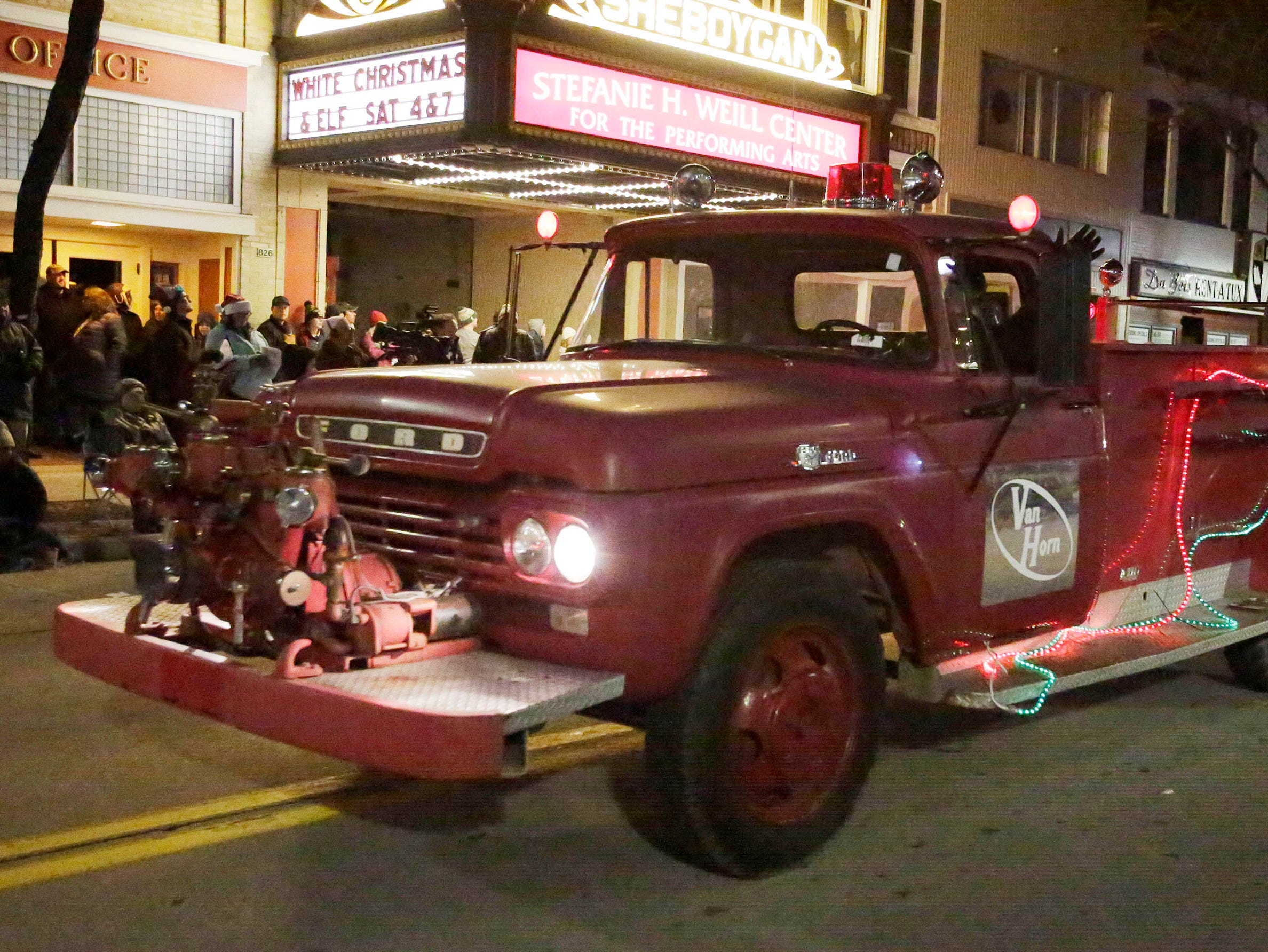 A vintage fire truck rolls along during the 26th Annual Jaycees Holiday Parade, Sunday, November 25, 2018 in Sheboygan, Wis.