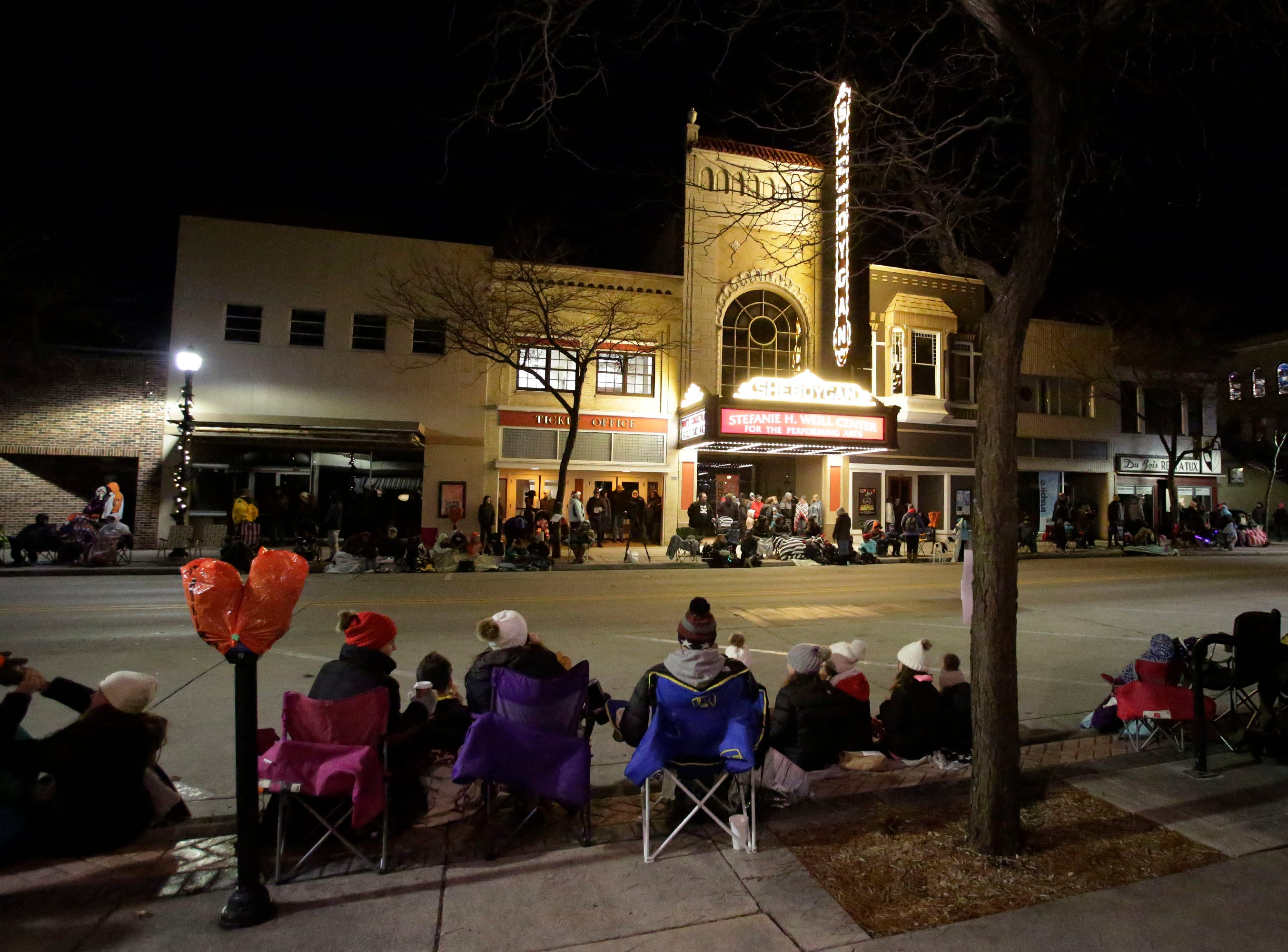 People line North 8th Street by the Stefanie H. Weill Center for the Performing Arts in preparation for the 26th Annual Jaycees Holiday Parade, Sunday, November 25, 2018 in Sheboygan, Wis.