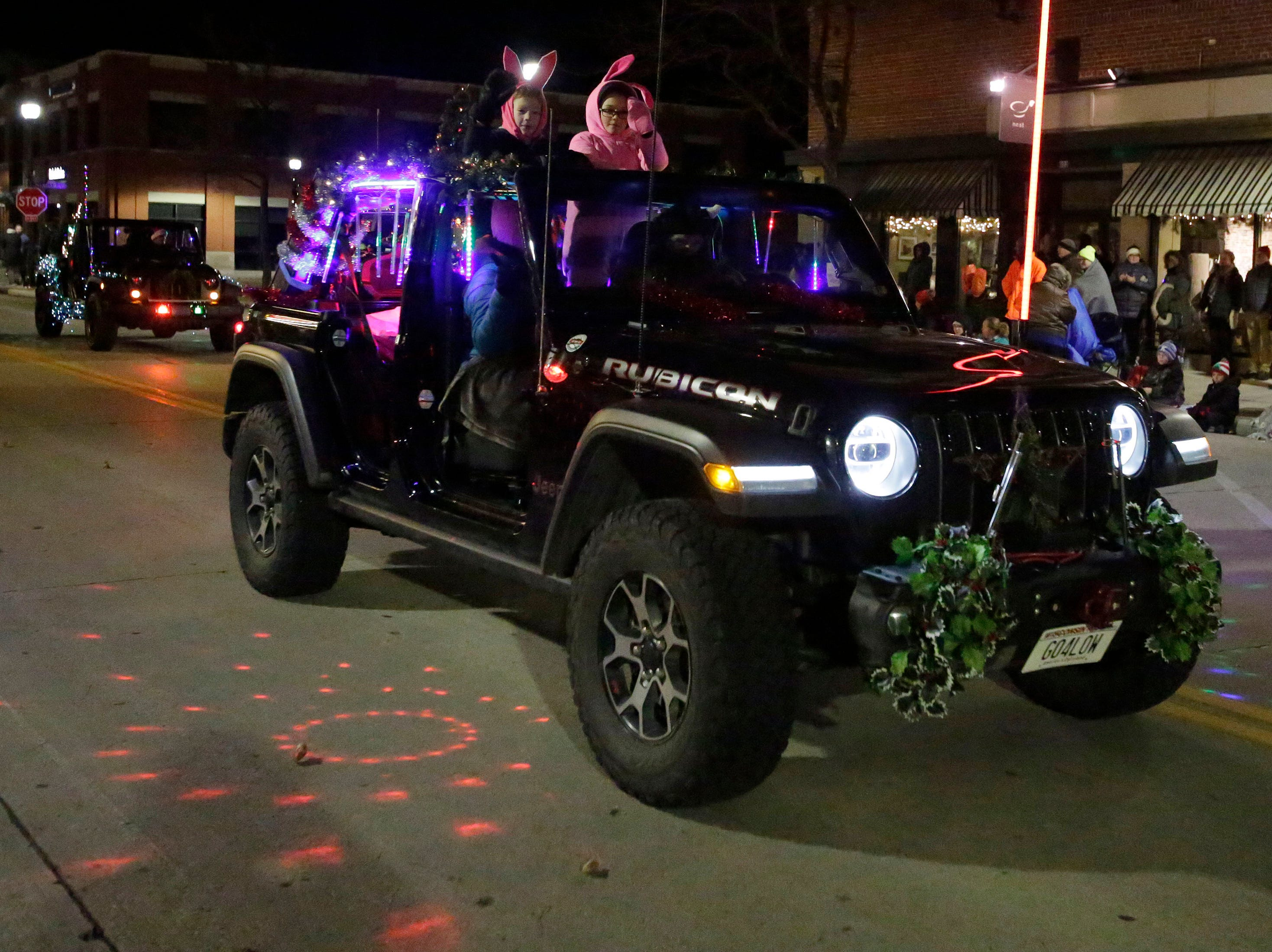 A Jeep lights the way at the 26th Annual Jaycees Holiday Parade, Sunday, November 25, 2018 in Sheboygan, Wis.
