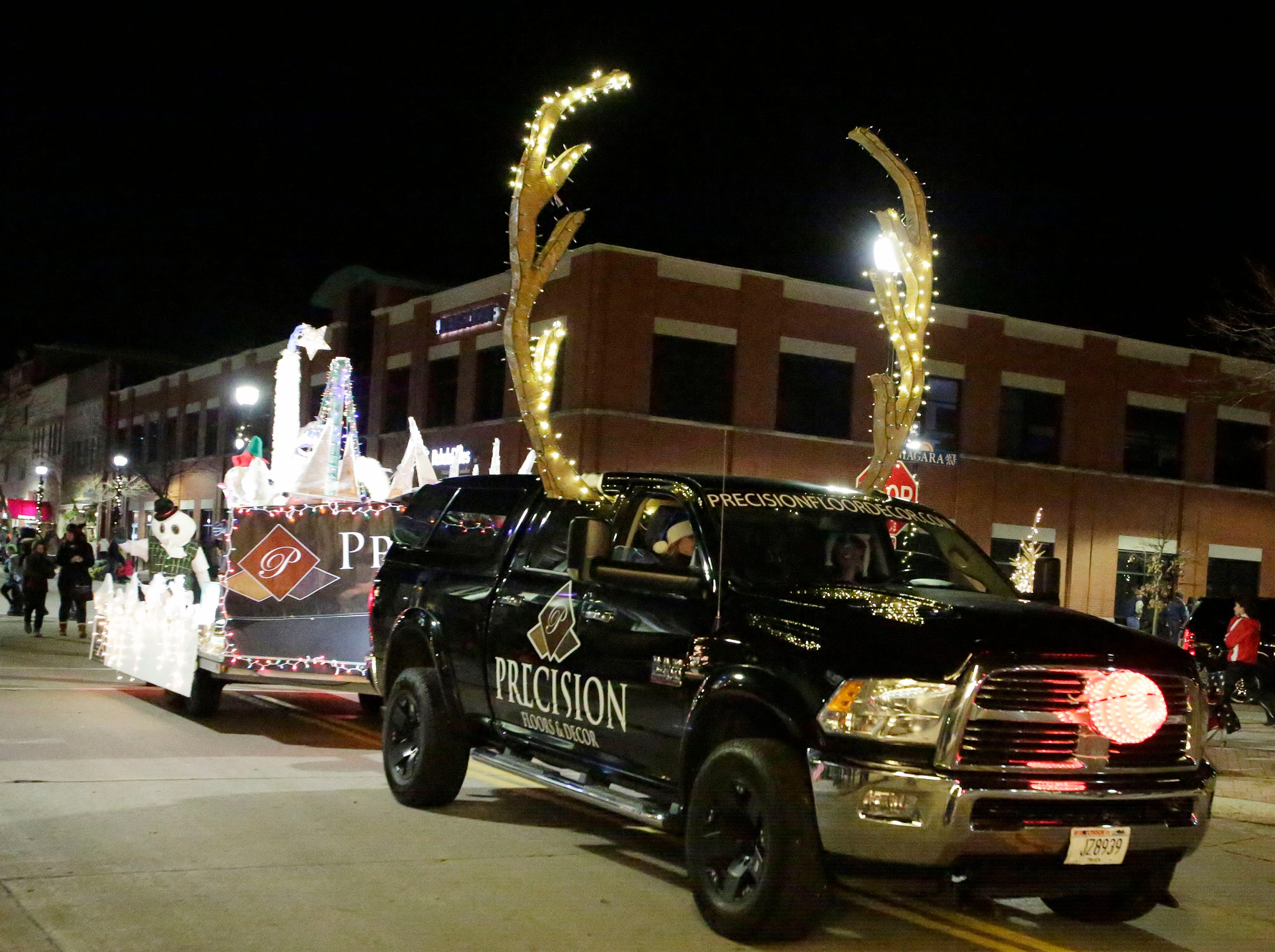Precision Flooring and decor rolls down North 8th Street at the 26th Annual Jaycees Holiday Parade, Sunday, November 25, 2018 in Sheboygan, Wis.  The company's corporate entry came in first place.
