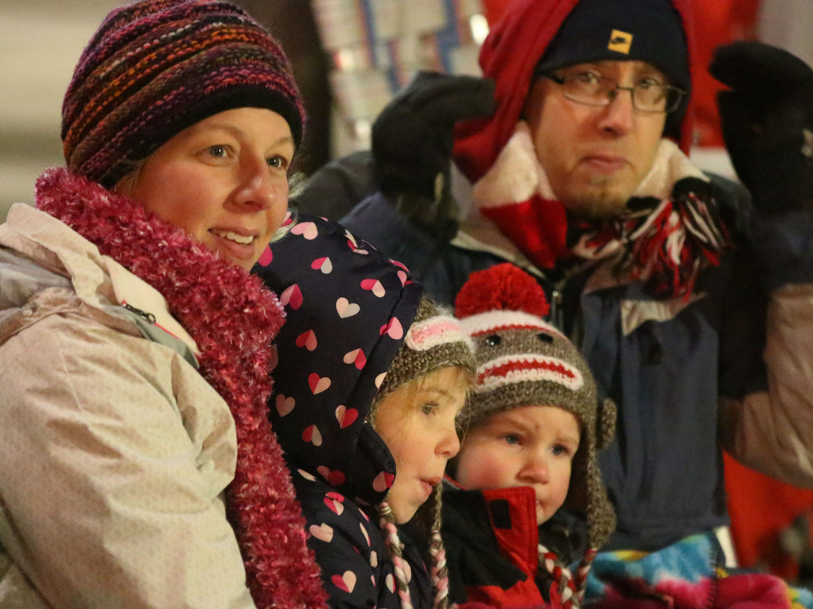 Elizabeth Burch, left, watches the parade with her children Hannah, 4, Elijah 2, and her husband Ryan during the 26th Annual Jaycees Holiday Parade, Sunday, November 25, 2018 in Sheboygan, Wis.