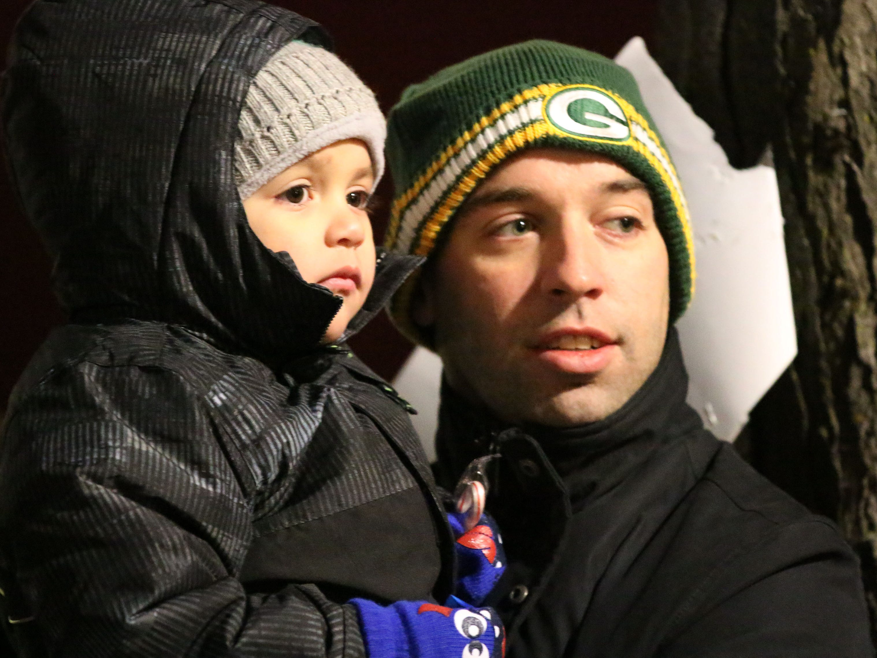 Brad Hoban of Sheboygan and his son Hudson, 4,  watch the 26th Annual Jaycees Holiday Parade, Sunday, November 25, 2018 in Sheboygan, Wis.