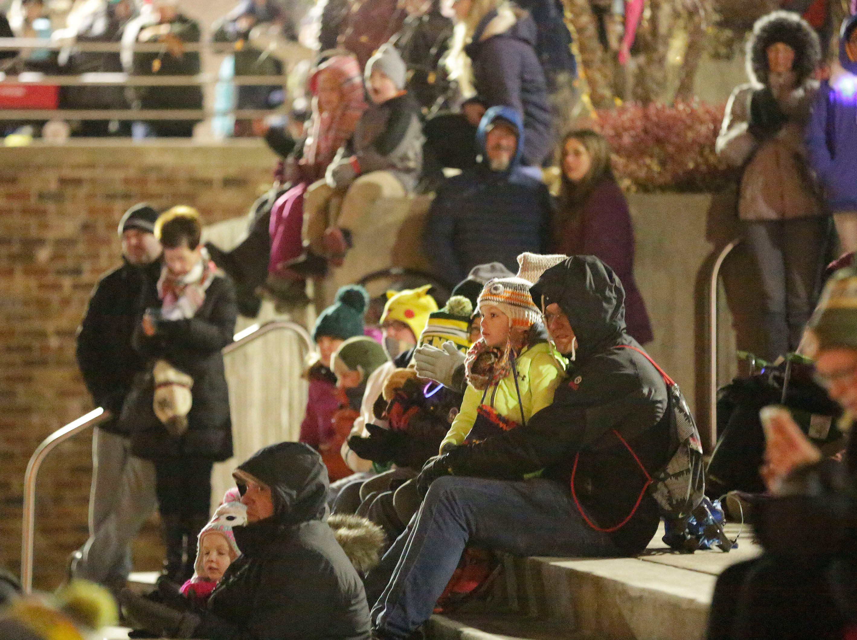 People wait for the tree lighting ceremony following the 26th Annual Jaycees Holiday Parade, Sunday, November 25, 2018 in Sheboygan, Wis.