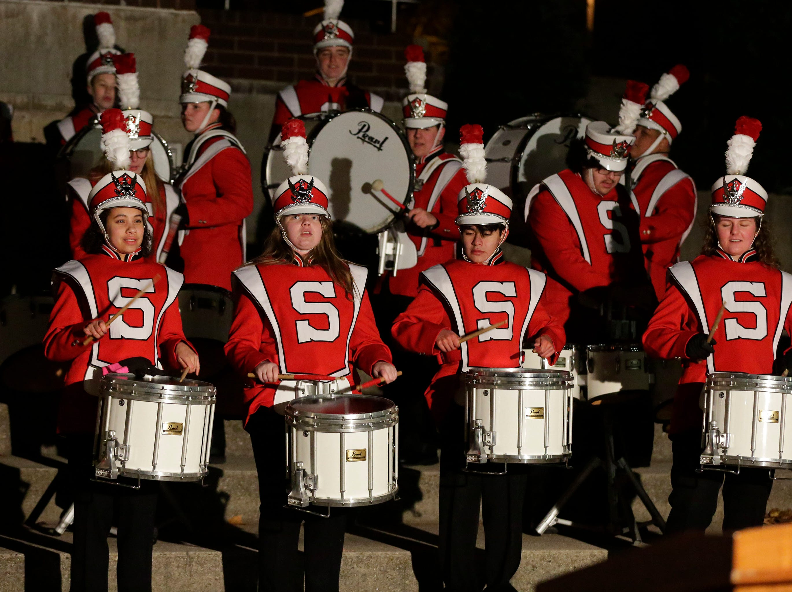 Sheboygan South's drum line performs before the tree lighting ceremony following the 26th Annual Jaycees Holiday Parade, Sunday, November 25, 2018 in Sheboygan, Wis.
