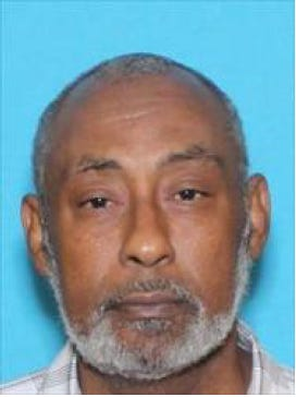 Michael Cooper, 57, is wanted on charges of distribution of a controlled substance resulting in serious bodily injury.