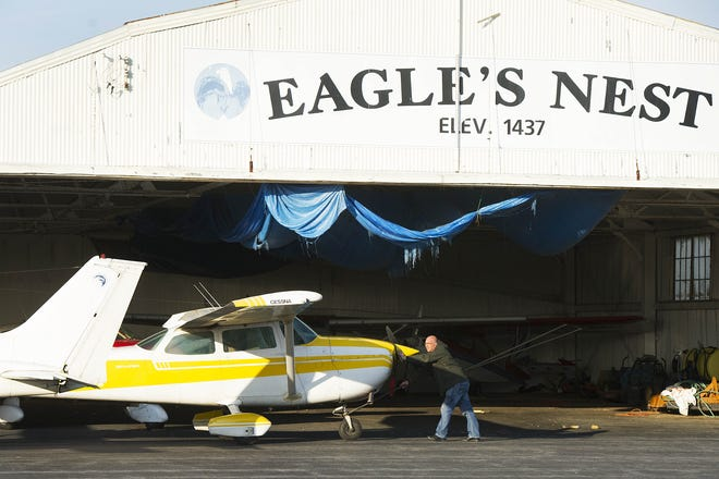Manager John Trissel readies a plane to go help out another pilot on April 7, 2013, at Eagle's Nest Airport in Waynesboro. Many of the pilots at Eagle's Nest express that their favorite part of flying is the ease of transportation. With hangars and runways in their backyards, they can easily get from one place to another without having to ever get in their car.