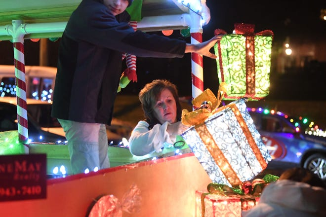 Karen Carpenter of Kline May Realty decorating their float on the night of the Christmas Parade on Nov. 26, 2018.