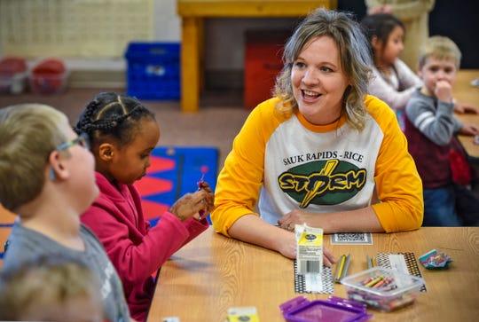 Teacher Laura Tate works with kindergarten students at Mississippi Heights Elementary School Monday, Nov. 26, in Sauk Rapids.
