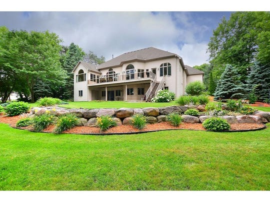 The landscaping at this stunning Otsego riverfront estate is so exquisitely managed it gives the feel of living in a gorgeous private park