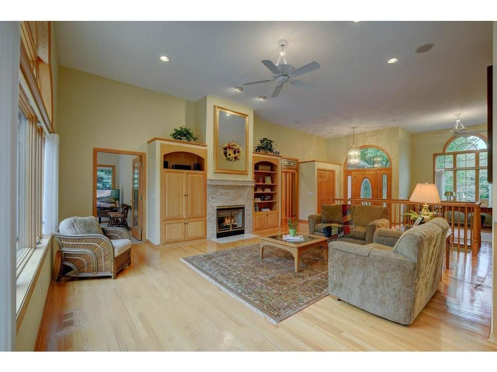 The vaulted ceiling, gas fireplace and lush built-in cabinetry make the wide open main space glow.