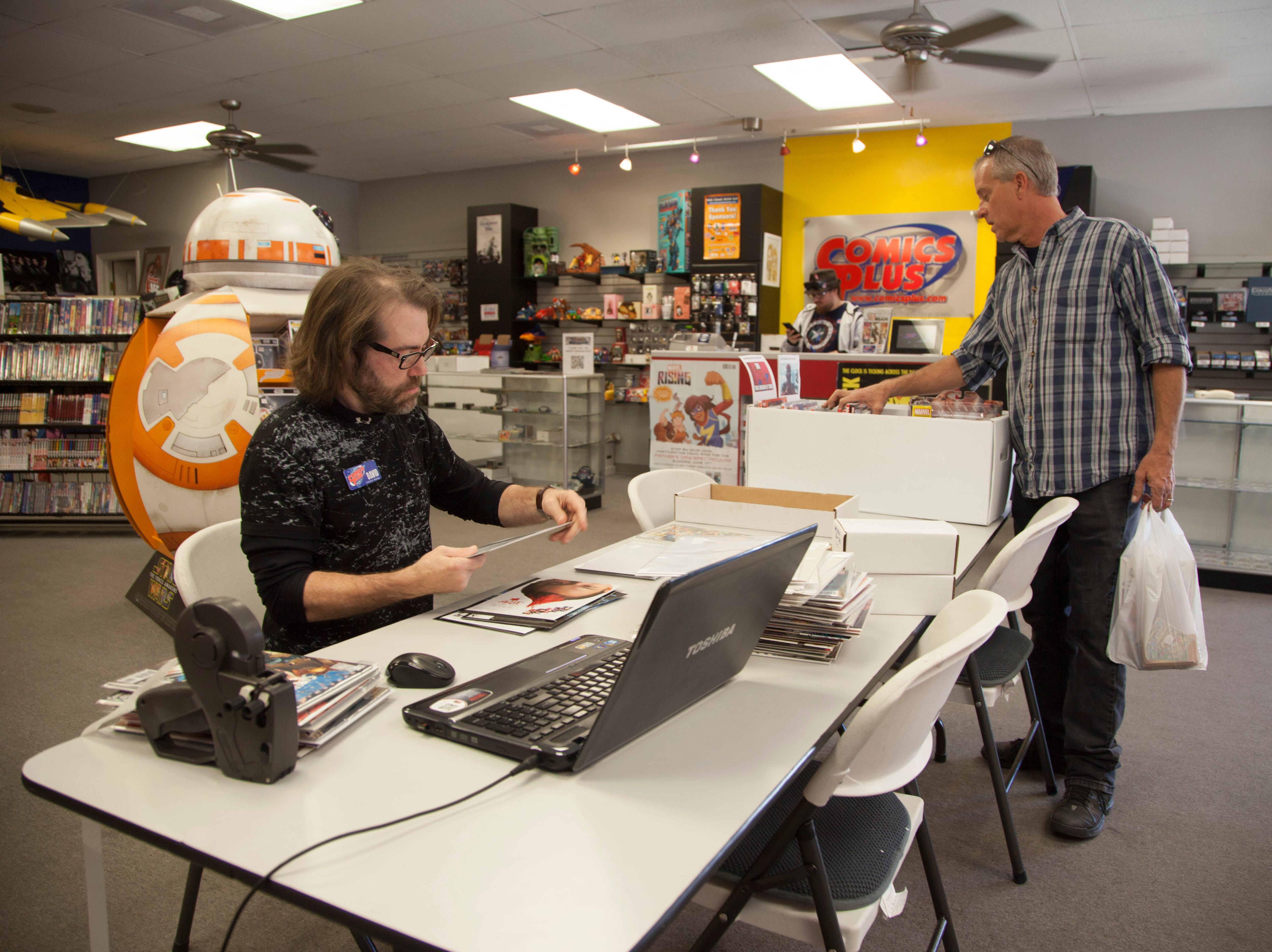 Community members recognize Small Business Saturday at Comics Plus Saturday, Nov. 24, 2018.