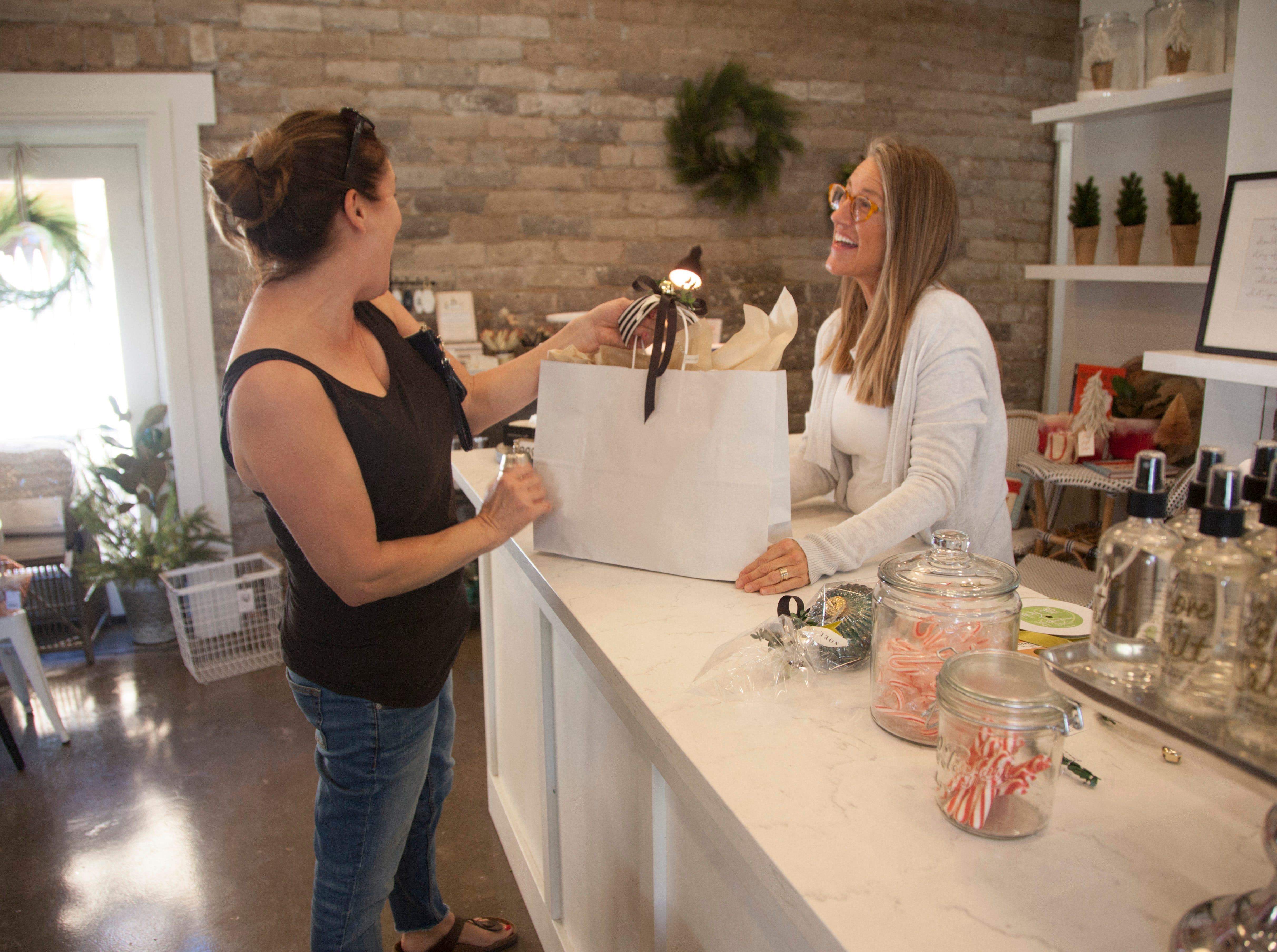 Community members recognize Small Business Saturday at Cosy House and Gifts Saturday, Nov. 24, 2018.