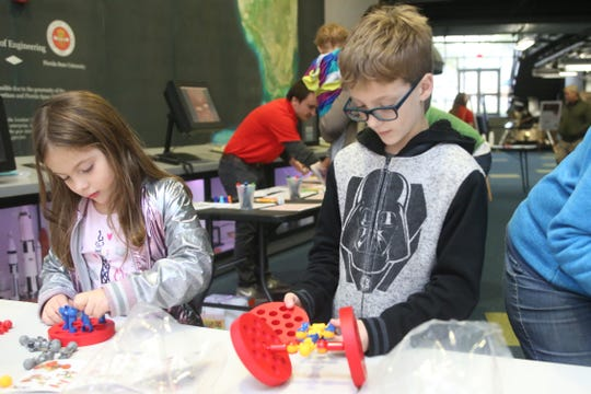 Sophie Fleming, 6, left, and Solly Fleming, 10, build rovers with Zoobs after a watch party at the Challenger Learning Center for the Mars rover landing, Monday, Nov. 26, 2018.