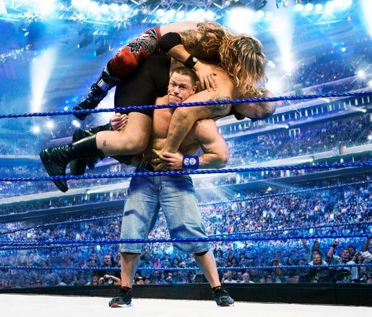 Pro-wrestler John Cena doing what made him famous.