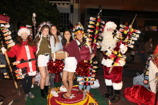 FSU fans get in on the fun with Santa at the Downtown Getdown on Friday.