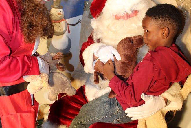 A visit with Santa brings joy to a little boy at the Downtown Getdown on Friday.