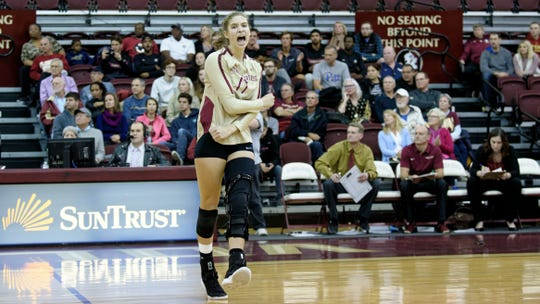 FSU setter Adrian Ell celebrates on the court at Tully Gymnasium.
