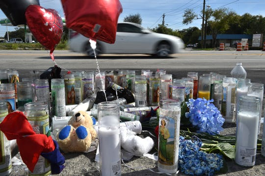 A road-side memorial seen with balloons, flowers, and stuffed animals, left in memory of the five victims of a horrific crash Friday, Nov. 23 on South 25th Street, at Midway Road in Fort Pierce.